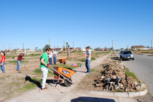 LUCAP volunteers preparing a lot for grass seeds in Joplin, MO.